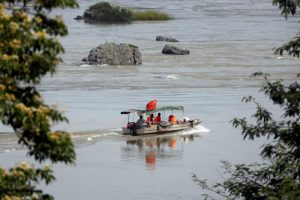 A Chinese boat with a team of geologists surveys the Mekong River, at the border between Laos and Thailand April 23, 2017. Picture taken April 23, 2017. REUTERS/Jorge Silva