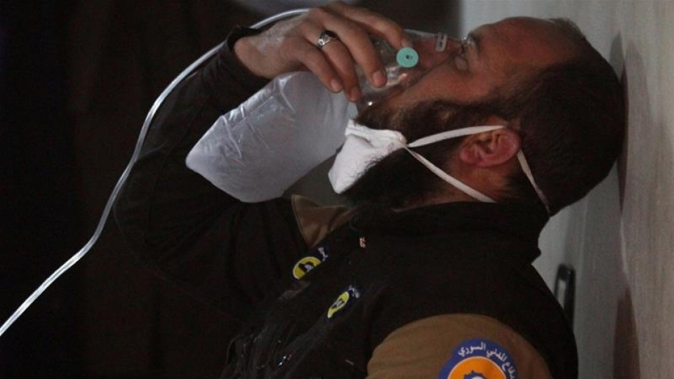 094841_A_civil_defence_member_breathes_through_an_oxygen_mask_after_a_suspected_gas_attack_in_the_town_of_Khan_Sheikhoun_Syria_April_4_2017._Reuters.jpg